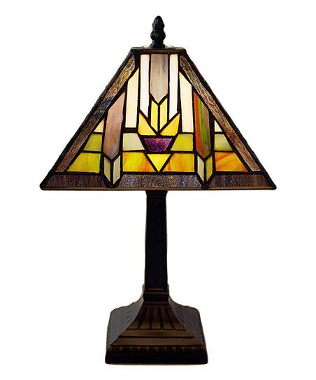 Add Southwestern appeal to home décor with this stained glass lamp that refracts light beautifully through its colorful shade.