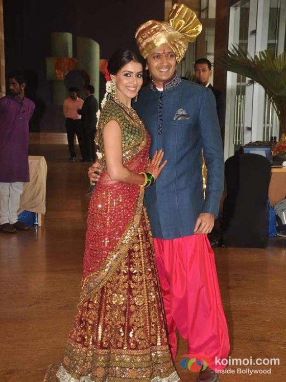 ritesh deshmuk at his brothers wedding.. love the blue and pink combination. what a perfect indo western style.