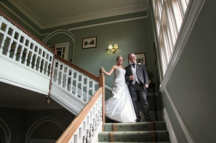 fab shot of coming down the stairs to their ceremony