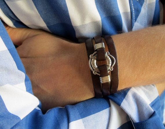 "Men's Bracelet - Men's Nautical Bracelet - Men's Leather Bracelet - Men's Brown Bracelet - Mens Jewelry - Jewelry For Men - Gift for Him  Looking for a gift for your man? You've found the perfect item for this!   The simple and beautiful bracelet combines brown leather which wrap 3 times on hand and a silver plated life bet pendant.  Lengh: 22.8 (53 cm) + 2"" (5 cm) extension chain.  $34"