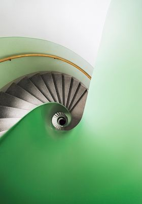 Green windling staircase in Stockholm, Sweden. Available as poster at printler.com, the marketplace for photo art. Photographer Calle Artmark