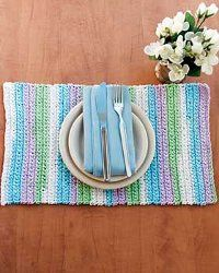 Sugar'n Cream Stripes Placemat- This pastel striped placemat would look wonderful on your table. Placemats are a decorative way to jazz up your space. Use this free knitting pattern to make a complete table setting.