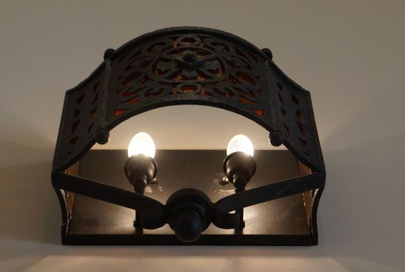 The Monarch Mediterranean Wall Sconce takes inspiration from a typical Old World wall sconce. Features hand forged scrollwork. Wrought iron light fixtures.