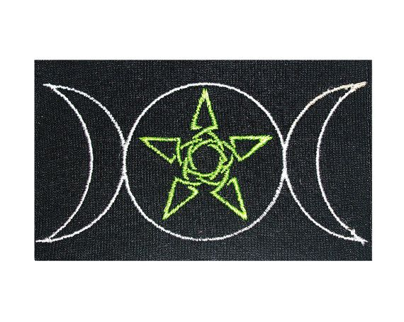 This is an embroidered patch featuring the symbol of the goddess moon or the different states of the moon cycle which is often associated with divine feminine influence. In the center of the full moon, we see a celtic star.  The size is 3.9 or 10cm across.  This symbol was designed by Jessie Matheny at Psysub using Adobe Photoshop, using a multi-layered system. It was then programmed into an embroidery pattern.  We used neon poly string to embroider this symbol onto a sturdy, thick, knit…