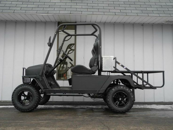Meet the Bad Dog! This golf car is built on an E-Z-GO MPT1200 chassis, but every piece has been customized with a 23HP Briggs & Stratton big block v-twin gas engine, 6-inch lift kit, black Line-X body, roll cage, aluminum diamond plate tool box and much more. Available now for $6990. See more at: http://www.powerequipmentsolutions.com/products-a-services/online-store/used-golf-carts/e-z-go-golf-carts/e-z-go-gas-golf-carts/1999-mpt1200-e-z-go-bad-dog-street-ready-hot-rod-custom-golf-car.html