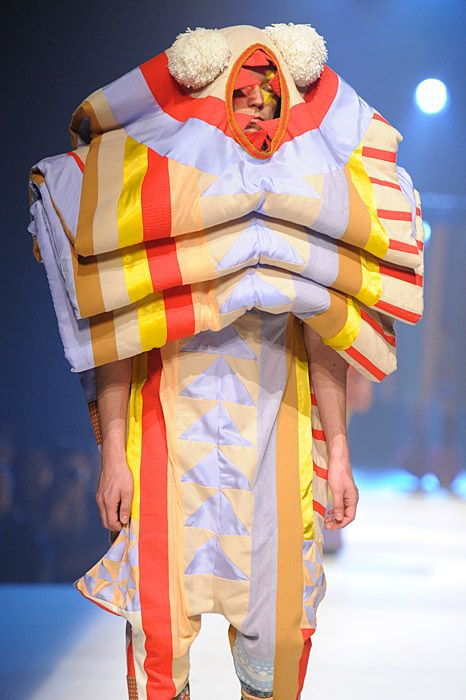 It's the ribbon candy, sleeping-bag-ish  bear-man!  Antwerp Fashion Department. Claire Michel.