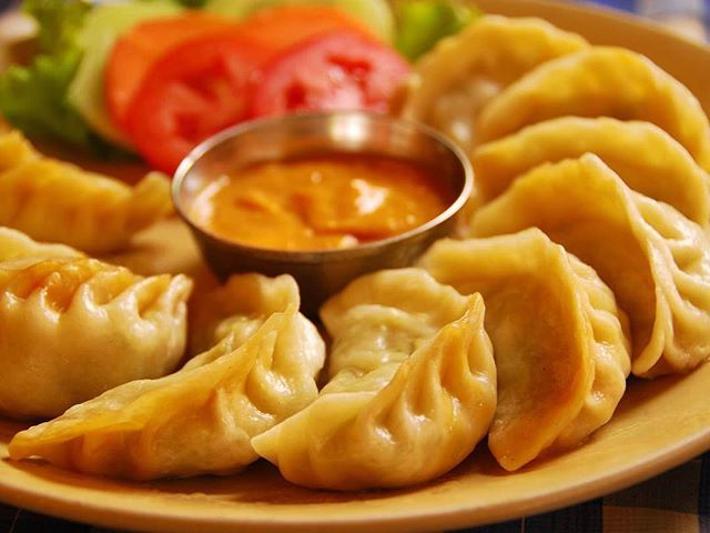 Today's Travel Tip:  #eat the world in #kathmandu the perfect end to a #trek in #nepal Pt4 A monument to #momos  #delicious  parcels of #meat #cheese or #vegetables  wrapped in wheat-flour shells, the momo is the dish that binds #tibet #nepal and #india together – transported across the mountains by the wandering #monks  who introduced Tibetan #buddhism to the #himalaya  These magnificent morsels come steamed or fried, with a side dollop of #spicychillisauce  both locals and tourists agree…
