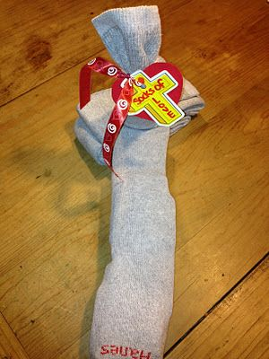 Stuff a sock with needed items, including the other sock! Great idea for kids!