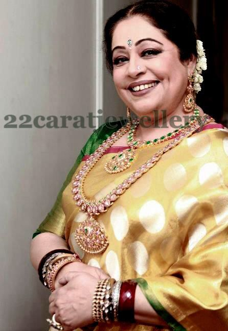 Kiron Kher in gold polka Saree with temple jewellery. Description by Pinner Mahua Roy Chowdhury.