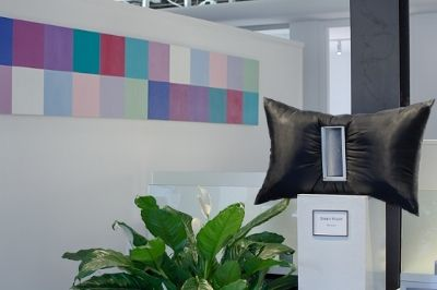 The interest lies in the relationship of color-to-color and block-to-block and was created to accentuate the contemporary, clean, clear and fresh office decor at Buyer's Edge.