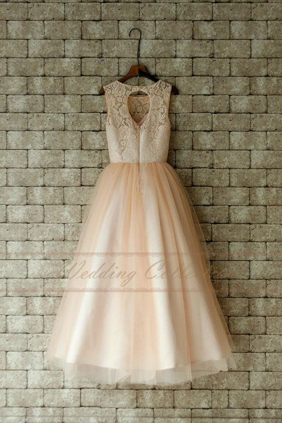 Fabric:Tulle,Lace Silhouette:Al ine Strap: Strapless Hemline: Floor Length Back: Zipper Color : Blush  Q: How long it will take to make a dress? And how about the shipping time? A: One Month (For rush service,pls contact us) Shipping time: 5~7 days by DHL Q: Do you accept custom made? A: We accept custom made. Whats more, you dont have to pay more for a custom dress.  Q: How to choose the size? A: Please refer to the size picture attached after the dress.  Q: What should I do if I want to…
