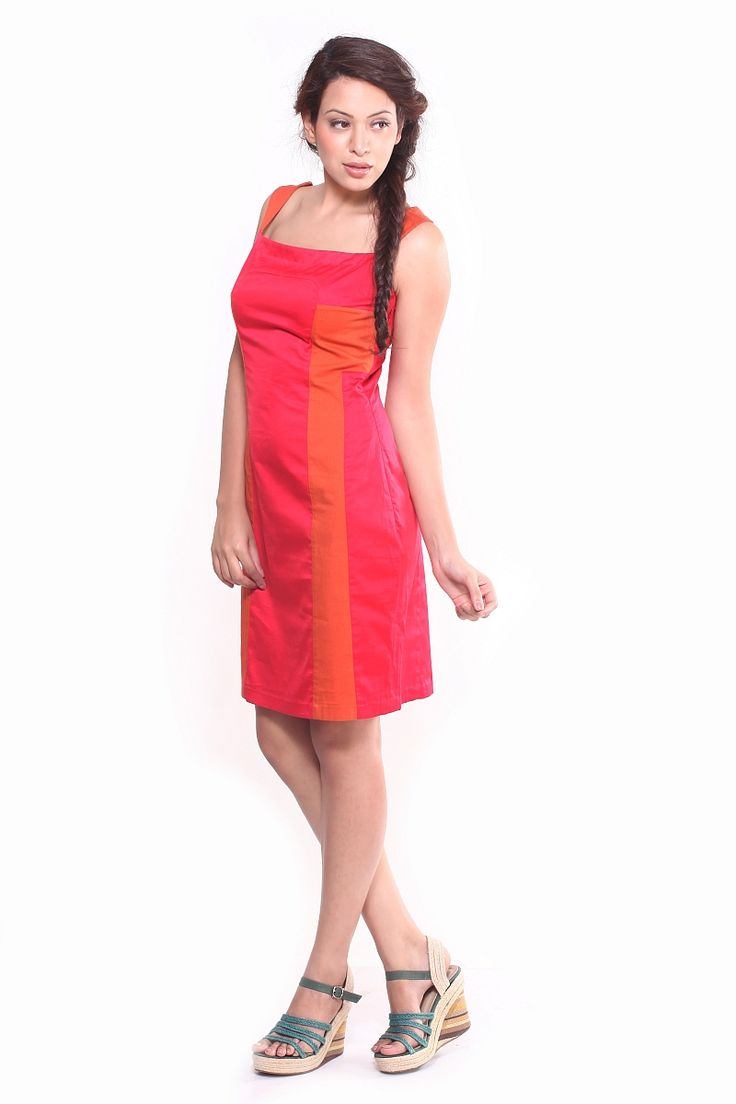 Paint the town red! In this dashing red cotton satin straight fitted dress. The side panels come in a bright orange lycra, which give a better fit therefore shaping your body. Makes this outfit great for any body type. Wear with a nice pair of turquoise sandals, matching jewellery and definitely wear your hair down with this number.  Material:  Cotton and Lycra
