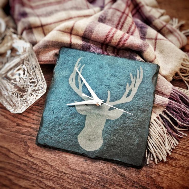 A beautiful hand crafted slate clock engraved with a stag's head.  Perfect for any country, rustic home decor.  Living room decorating   Country Homes and Interiors   www.plattersinteriors.co.uk