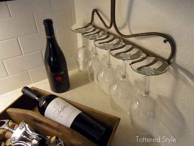 Take the handle off an old rake and turn it into a wineglass rack. | 27 Clever Ways To Use Everyday Stuff In The Kitchen