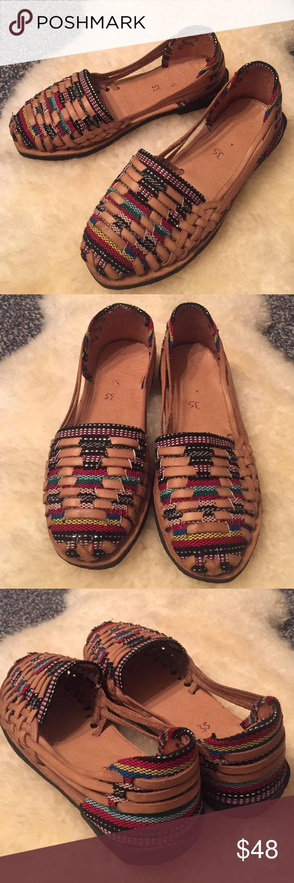 Handmade Huaraches Mexican Sandals Never been worn Mexican Huaraches sandals. Handmade from yucatan, Mexico. Leather and colorful fabric woven on top and back of the sandal. Says size 35- Fits a size 6 runs small but they do stretch out and form to your feet once you wear them in and become the most comfortable ever! **not free people Free People Shoes Sandals