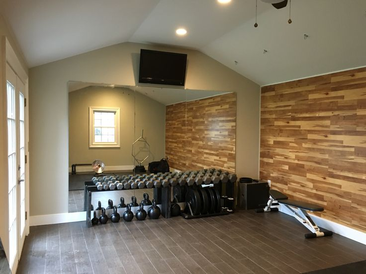Garage converted into a nice cozy gym/personal training studio, it's equipped with anchors for suspension training, gymnastic rings, rubber matting, plenty of dumb bells, kettlebells, bumper plates, hex bar and oly bar, parallettes,