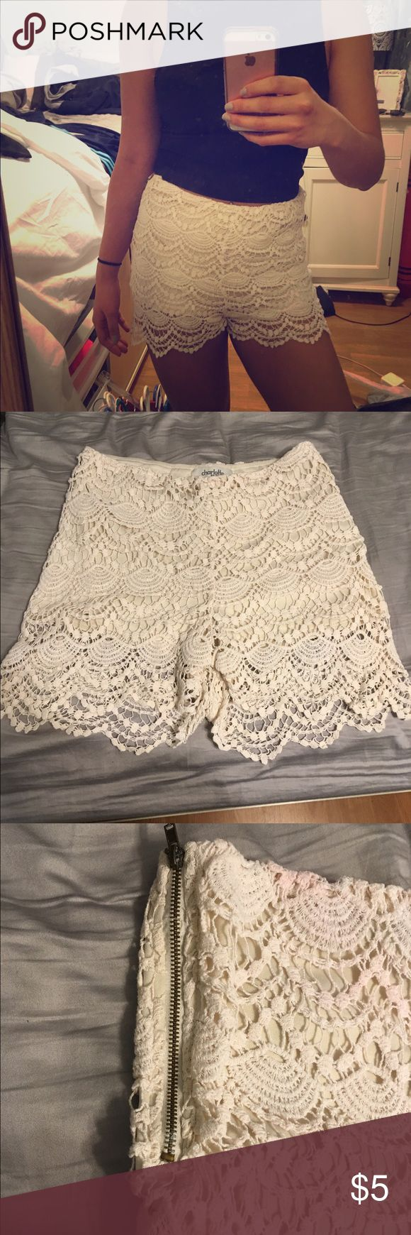 Charlotte Russe Cream Lace shorts Cute Cream Lace shorts from Charlotte Russe! Size medium but can fit size small. Has a some faint red staining at the top in the back. Zipper is on the side, sometimes slips down. Charlotte Russe Shorts