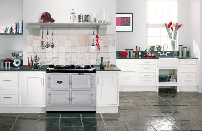 The 3-oven AGA cooker in Pearl Ashes. Placed in a contemporary kitchen.