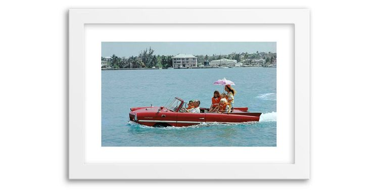 Slim aarons - Film producer Kevin McClory takes his wife Bobo Sigrist and their family for a drive in an 'Amphicar' across the harbour at Nassau. The children are Bianca Juarez (Bobo's daughter from another...