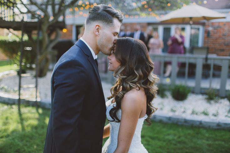 Wedding Photography in Windsor Ontario - Groom Kisses HIs Bride on the Forehead - Curescu Photography