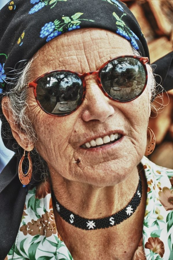 Photograph A old gypsy woman by Yasmine DG. What stories she could tell, I'm sure, living a less restrained life than the vast majority:
