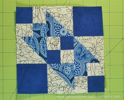 A Broken Sugar Bowl quilt block with its strong diagonal design uses simple triangle squares and 4-patches. Complete instructions for the beginner!