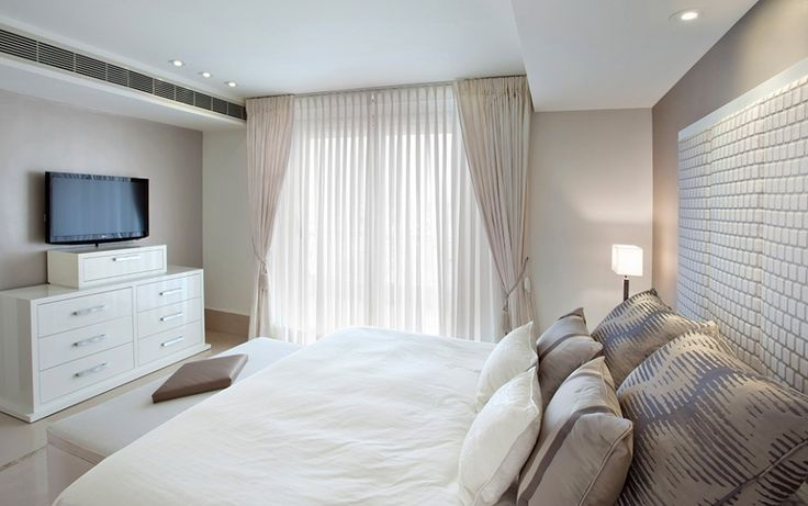 Home & Apartment  White  Cream  Table  Light  Beside  White  Sheer  And  Cream  Curtain  Cobine  With  Cream  Wall  Bed  Room  With  White  Bed  And  Light  Brown  Pillow  Together  Brown  White  Puffy  Sofa  And  Cream  W Easy on The Eye Luxurious Apartment Sea View in Tel Aviv by Daniel Hasson