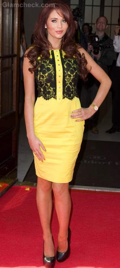 Amy Childs in a yellow pencil fit dress with black crochet detailing