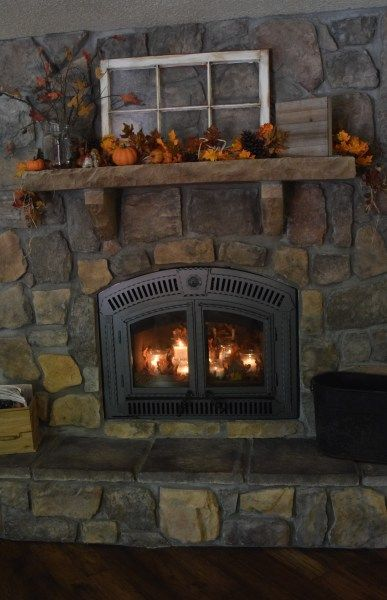 Fall Stone Fireplace Mantle With Old Window Pumpkins And