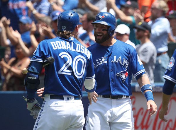 Kevin Pillar #11 of the Toronto Blue Jays is congratulated by Josh Donaldson #20 after scoring a run in the second inning during MLB game action against the Detroit Tigers on July 10, 2016 at Rogers Centre in Toronto, Ontario, Canada.