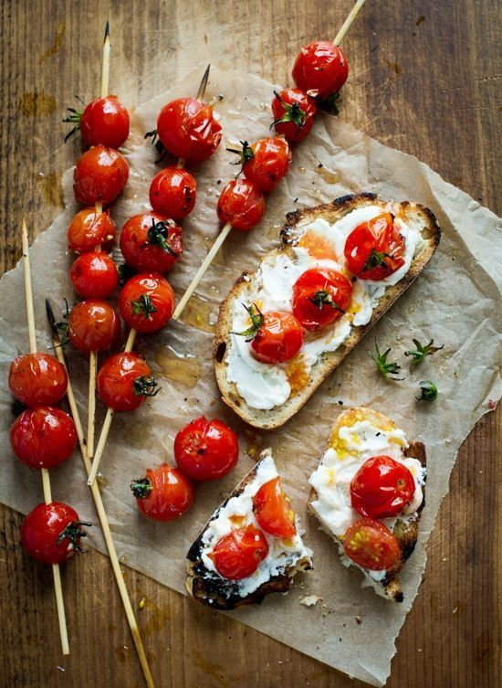 Grilled tomatoe lollipop toasts with with cheese or creme fraiche and garlic ahhhh