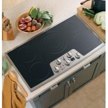"GE Profile 36"" Built-In CleanDesign Cooktop. Feature include: Ceramic-glass cooktop, Ribbon heating elements, 6 /9 /12 tri-ring element,   5 /8 Dual element, Bridge element,  & Heavy-duty knobs. Want to learn more? Visit us online at http://www.swappliances.com"