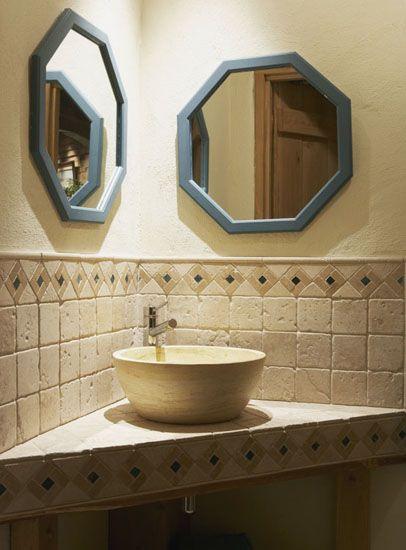 Stone corner sink unit in downstairs WC.