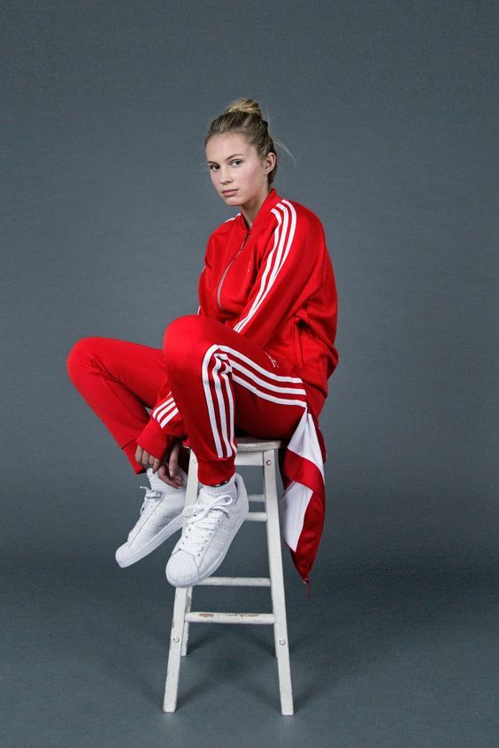 Streetwear style at its finest—track suit and clean, white kicks.