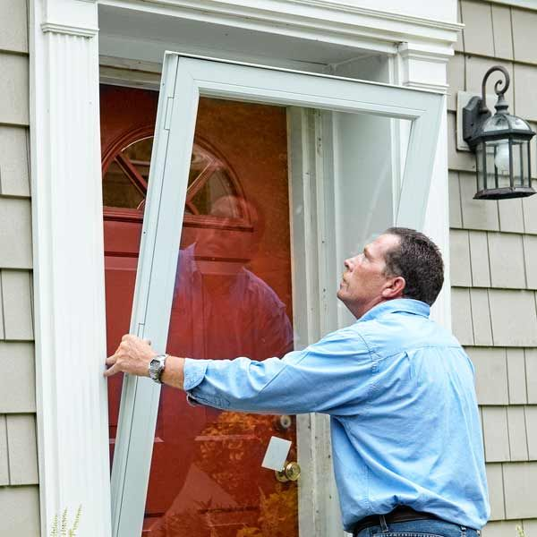 A tightly weatherstripped storm door can reduce air leakage around a front door by as much as 45 percent. Follow our step-by-steps to learn how to install one. | Photo: Ryan Benyi | thisoldhouse.com