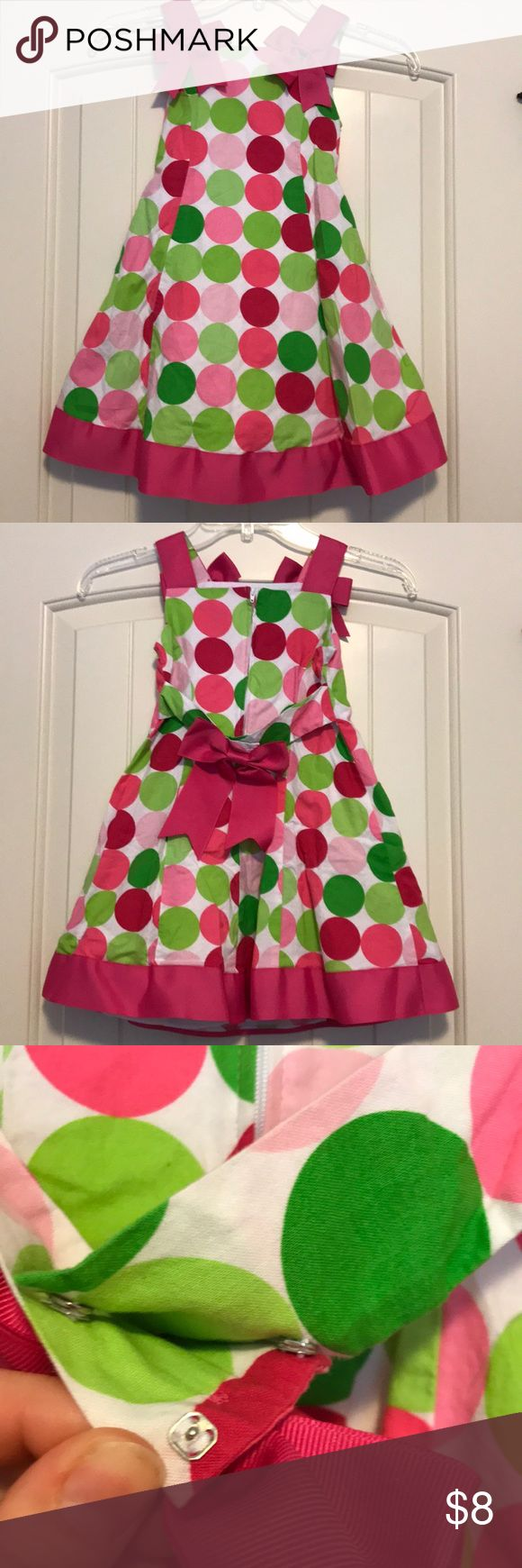 "VGUC Pink and Green Toddler Dress This is a beautiful pink and green toddler dress. I have classified this dress as ""very good"" and not ""excellent"" because there is one eye from the hook and eyes on the bow missing (picture included). This dress has no stains and is in great condition. Bonnie Jean Dresses Casual"