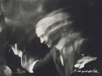 ANTON GIULIO BRAGAGLIA (1889-1963)  Salutando, 1911  gelatin silver print  signed in white ink (on the recto); 'Foto Bragaglia Roma' credit stamp (on the verso)  image: 3 1/8 x 4¼in. (8 x 10.7cm.)  sheet: 3¼ x 4 3/8in. (8.3 x 11.2cm.)