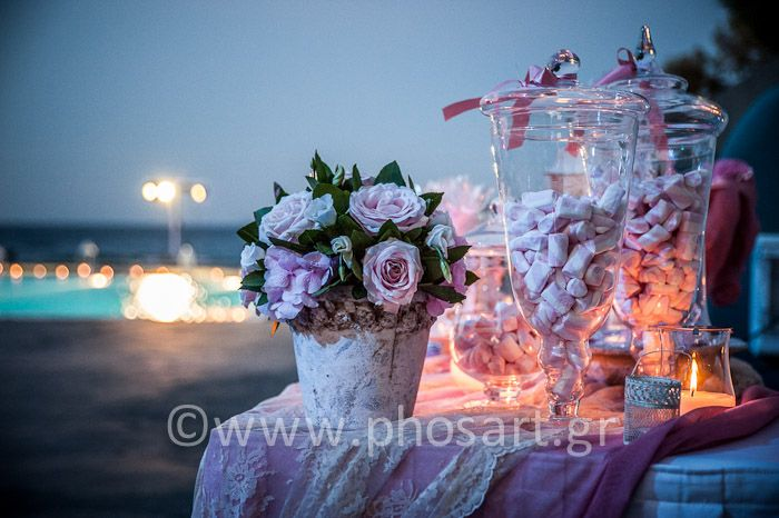 Welcome table and candy bar in Ariana's Christening! Marshmallows in glass vases for a sweet decoration. Sweet avalanche roses, lace, candles and pearls for a romantic event!  Conceptualization, flower creations & design: Wedding Wish Santorini | www.weddingwish.com.gr Photographer: Studio Phosart | ww.photographergr...