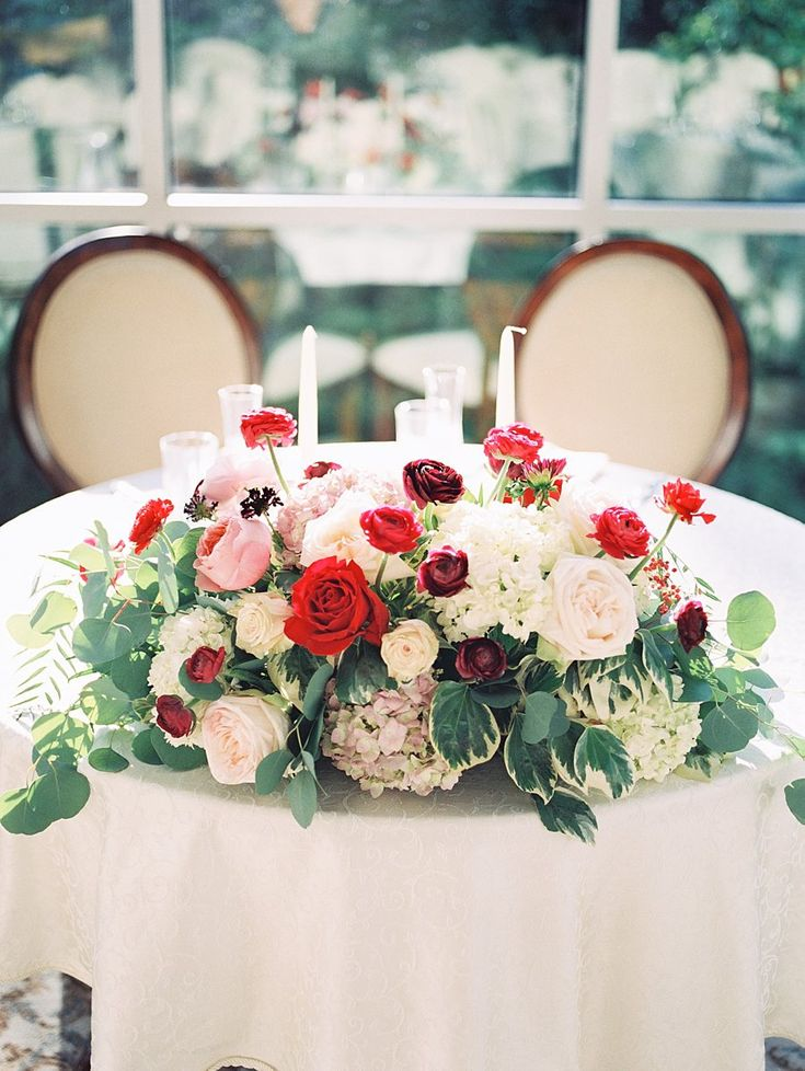 Sweetheart Table with Red and White Flowers | photography by http://www.tracyenochphotography.com