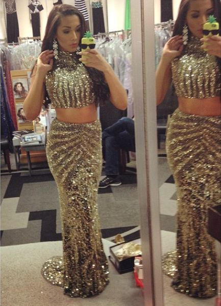 Gabi Lopez looks amazing in her two piece prom dress! Loving the gold sparkle and the long skirt.