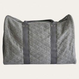 Boasting functional and style quotients in equal portion, our new Cabin Bag is fashioned from a charcoal or black, soft quilted fabric, contrasted with sturdy canvas sides and a polkadot interior. With the versatility of handles and an across-body strap, its relaxed but roomy interior will happily hold your gear for a short haul flight or overnight adventure, fitting in to a plane cabin locker with ease.