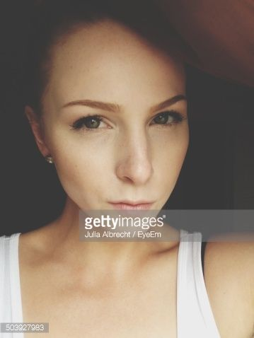 Stockfoto : Portrait of a beautiful young woman over black background