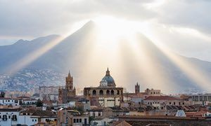 Film set of a city … the sun goes down over Palermo