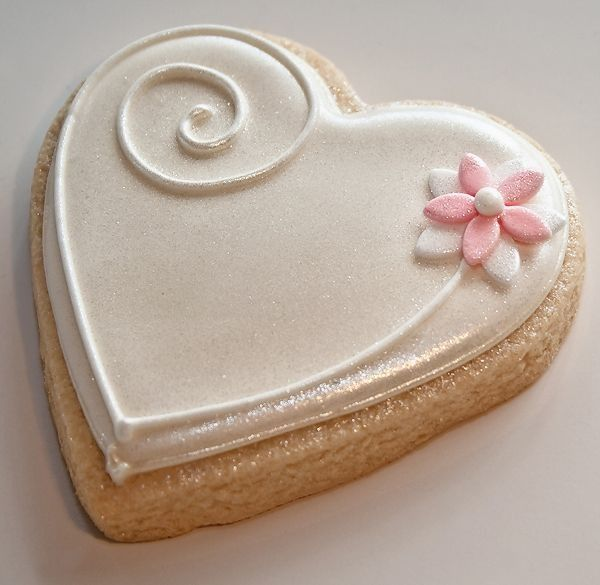 White heart cookie with pink flower cookie