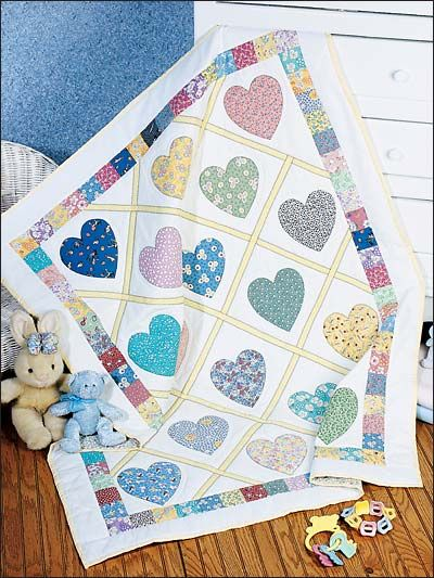 Love & Kisses Baby Quilt Pattern Download from e-PatternsCentral.com -- Hearts cut from pastel scraps make the perfect quilt design for Baby.