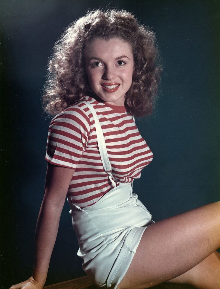 A young, brunette Marilyn Monroe posing in 1947, just before skyrocketing into a Hollywood legend