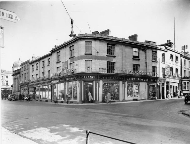The former Lewis & Godfrey store is now M & Co. Think it might have been a Co-Op or similar in the 1970s. Can remember shopping there with Mum. Stroud, Gloucestershire.