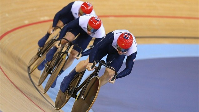 Philip Hindes (front), Jason Kenny (C) and Sir Chris Hoy (back) of Great Britain compete in the Men's Team Sprint Track Cycling Final on Day 6.