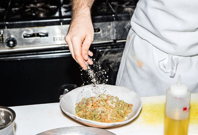 At Faro, a new Italian restaurant in Bushwick, the kitchen makes its flour from grains grown upstate and then turns it into inventive pasta shapes. There's also a wood-burning oven that does wonders with asparagus and octopus, animal-welfare-approved meat, and a minimalist dining room so cool and spacious that it looks like an imagined Los Angeles. http://nyr.kr/1hzJCD6 (Photograph by Jeremy Liebman)