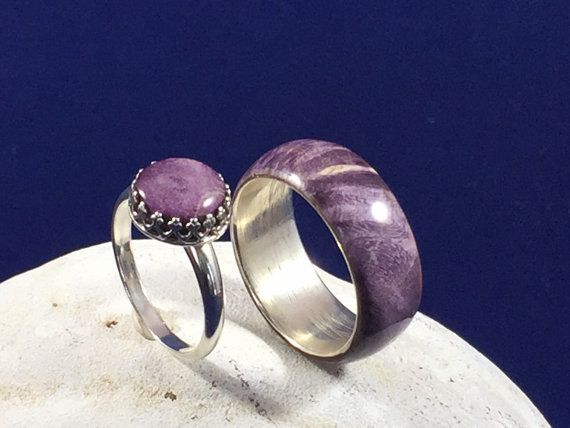 This is a gorgeous set of promise rings. Yes! It is actually wood. This is a stabilised Box Elder Burl with a purple color and makes stunning rings. The cathedral bezel makes for a very delicate and finely constructed cocktail ring while the solid band just shows off the gorgeous colors and patterns in the wood.